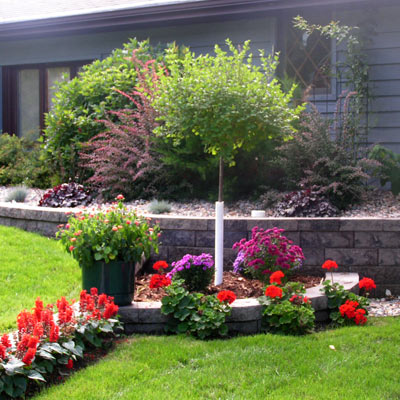 Home landscape with flower gardens and newly planted trees and shrubs